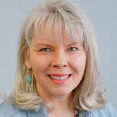 A headshot of Pam Jumonville